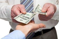Human hands exchanging money. Closeup shot stock photography
