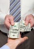 Human hands exchanging money. Closeup shot royalty free stock photography