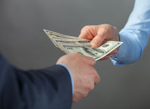 Human hands exchanging money. Closeup shot royalty free stock images