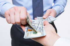 Human hands exchanging money. Closeup shot royalty free stock photo