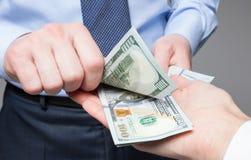 Human hands exchanging money. Closeup shot stock photos