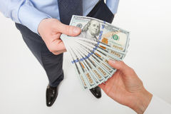 Human hands exchanging money. On neutral background, view from above royalty free stock images