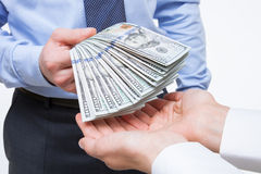Human hands exchanging money. On white background stock image