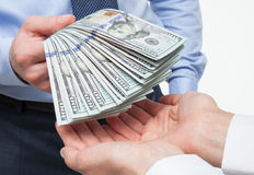 Human hands exchanging money. On white background royalty free stock image
