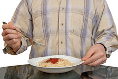 Human hands with fork and spaghetti Royalty Free Stock Photo
