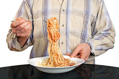 Human hands with fork and spaghetti Royalty Free Stock Photography