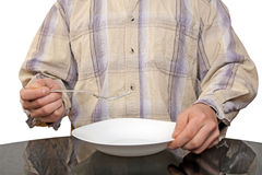 Human hands with fork and white plate Stock Photo