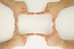 Human Hands Frame. Two sets of human hands are creating a rectangel frame Royalty Free Stock Photos