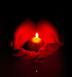 Human hands hold burning candle Royalty Free Stock Photo