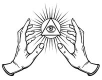 Human hands hold the shining triangle a symbol of eyes. Stock Photography
