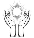 Human hands hold a symbol of the shining sun. Stock Images