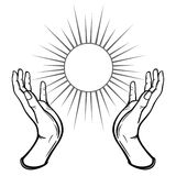 Human hands hold a symbol of the shining sun. Stock Photography