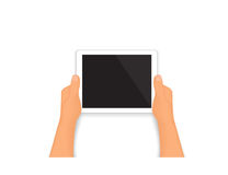 Human hands hold a tablet pc Royalty Free Stock Image