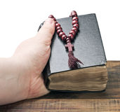 Human hands holding the Bible Stock Photo