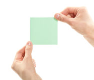 Human hands holding blank sticker/note/paper Royalty Free Stock Photography