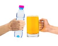 Human hands holding a bottle of water and beer glass isolated Royalty Free Stock Images
