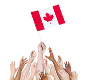 Human Hands Holding Canada Flag royalty free stock image