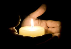Human hands holding candle Royalty Free Stock Photo