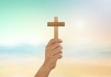 Human hands holding a cross. Holy and prayed for blessings from God. Amour Worship God concept Royalty Free Stock Photos