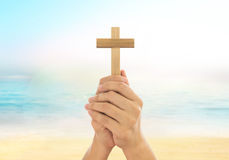 Human hands holding a cross. Holy and prayed for blessings from God. Amour Worship God concept Stock Image