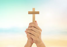 Human hands holding a cross. Holy and prayed for blessings from God. Amour Worship God concept Stock Photos