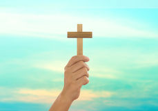 Human hands holding a cross. Holy and prayed for blessings from God. Amour Worship God concept Royalty Free Stock Image