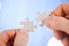 Human hands holding details of puzzle Royalty Free Stock Image