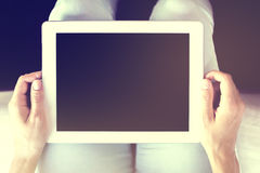 Human hands holding digital tablet Stock Image