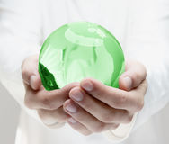 Human hands holding earth Stock Image