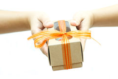 Human hands holding a gift Royalty Free Stock Photo