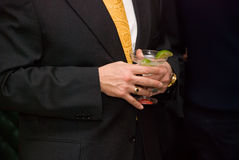 Human hands holding the glasses of cocktail. Royalty Free Stock Photo