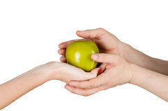 Human hands holding green apple Stock Photography