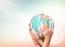 Human hands holding green planet. Royalty Free Stock Image