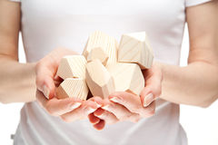 Human hands holding heap of wooden blocks Royalty Free Stock Photos