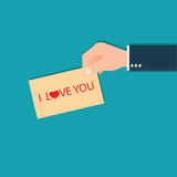 Human hands holding I love You Lettering Card. Royalty Free Stock Photography