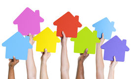 Human hands holding icon houses.  royalty free stock photo