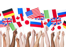 Human Hands Holding International Flags Royalty Free Stock Photos