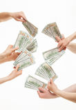 Human hands holding many dollars Stock Photo