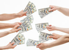 Human hands holding many dollars Stock Images