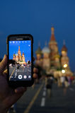 Human hands holding mobile phone, taking a photo of the Moscow K Royalty Free Stock Photography