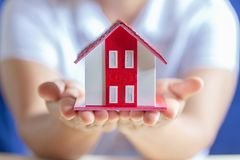Human hands holding model of dream house. stock images