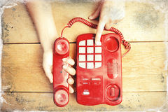 Human hands holding phone handle and dialing Royalty Free Stock Images