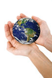 Human hands holding planet Earth royalty free stock photography