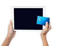Human hands holding tablet pc and credit card Royalty Free Stock Photography