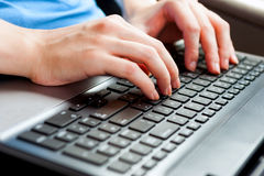 Human Hands on the laptop keyboard close up Royalty Free Stock Photo