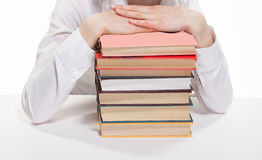 Human hands liyng on a stack of books. White background Royalty Free Stock Photos