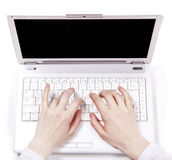 Human hands over laptop keypad during typing. Royalty Free Stock Images