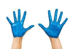 Human hands painted with blue color Royalty Free Stock Photos
