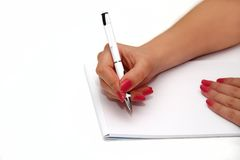 Human hands with pencil and erase rubber writting something Stock Image