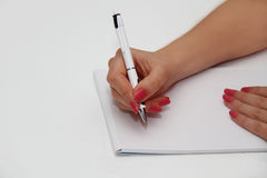 Human hands with pencil and erase rubber writting something Stock Photo